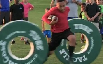 Watch Kids Learning Dodge Skills With Tackle Tube